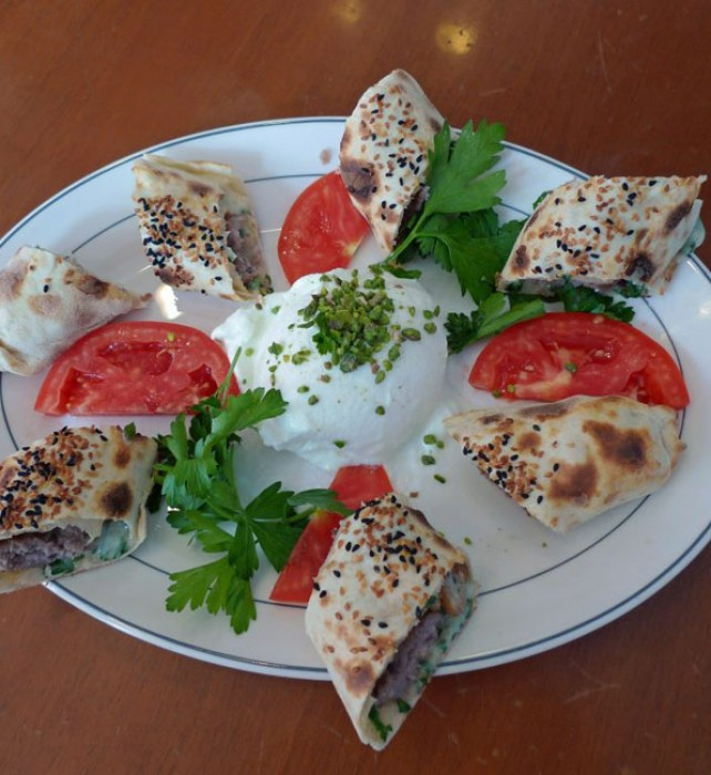 Ciya Kebap baked in thin bread dough and served with fresh cheese.