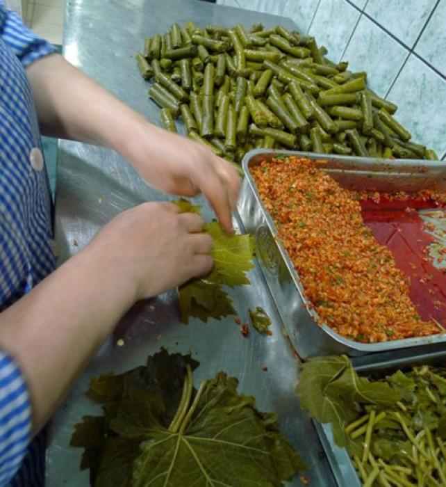 Rolling bulgur dolmas at Siya's prep-kitchen