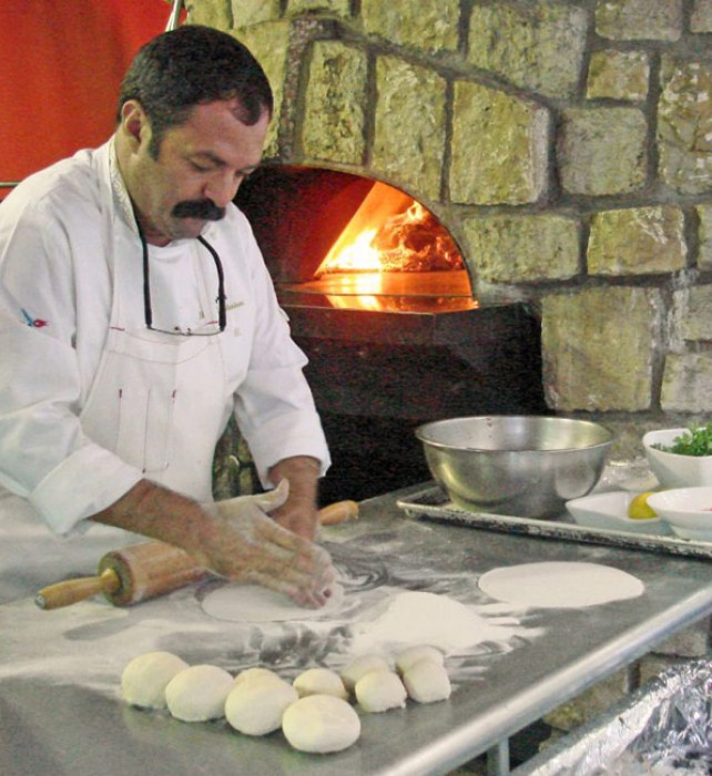 Musa Dağdeviren prepares his Lachmacun (Arab Pizza) at Graystone, in Napa, and he grills his exquisite Liver Kebap (see recipe).
