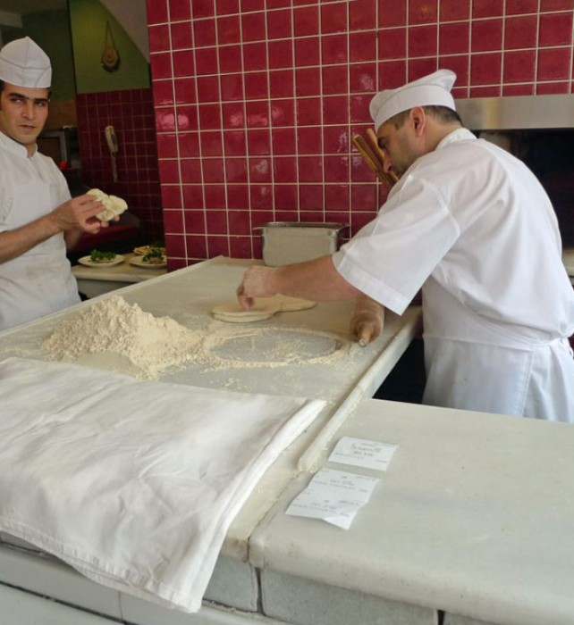 The baker bakes pita bread constantly at Ciya.