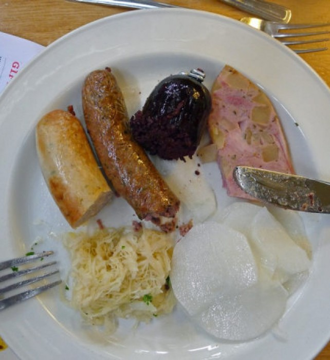 Saturday LUNCH Wursts radishes and sauercraut on my plate.