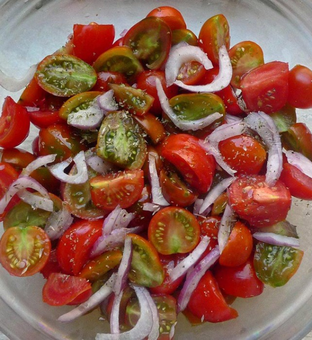 We devour copious amounts of tomatoes every day, simply dressed just with fruity olive oil and a sprinkling of dry oregano; onion rings and home-made capers are some favorite embellishments.